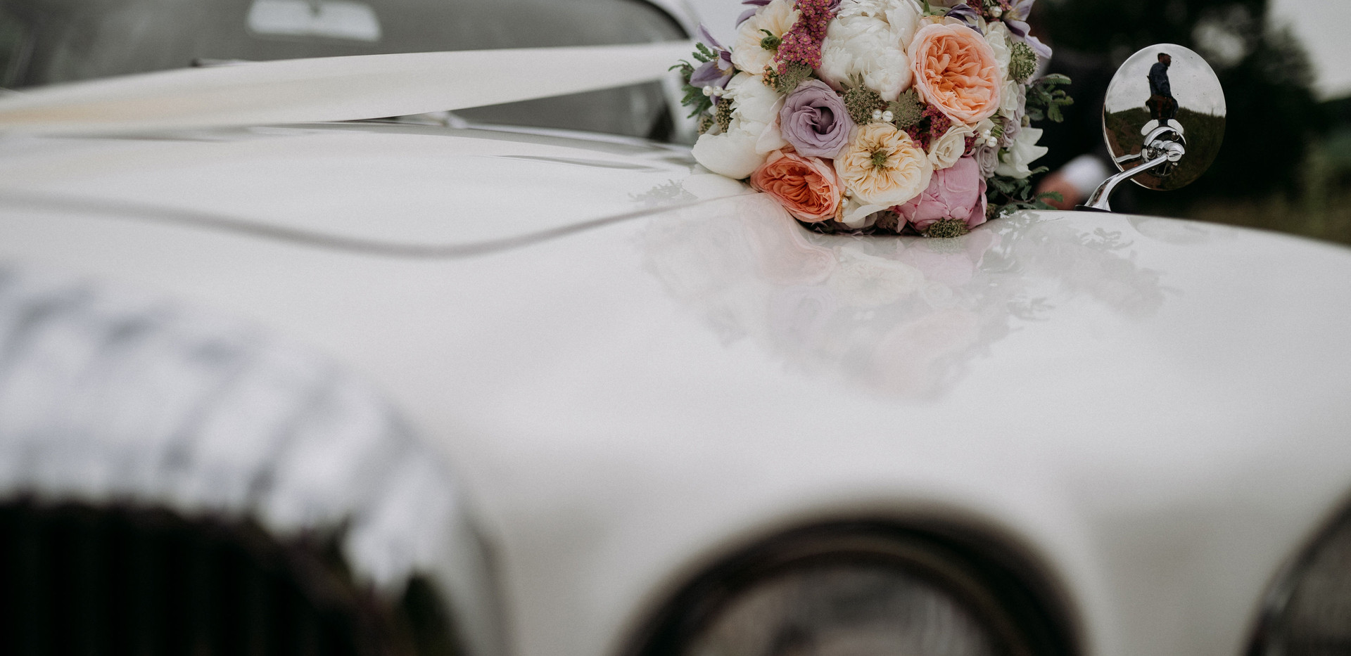 Wedding bouquet and car