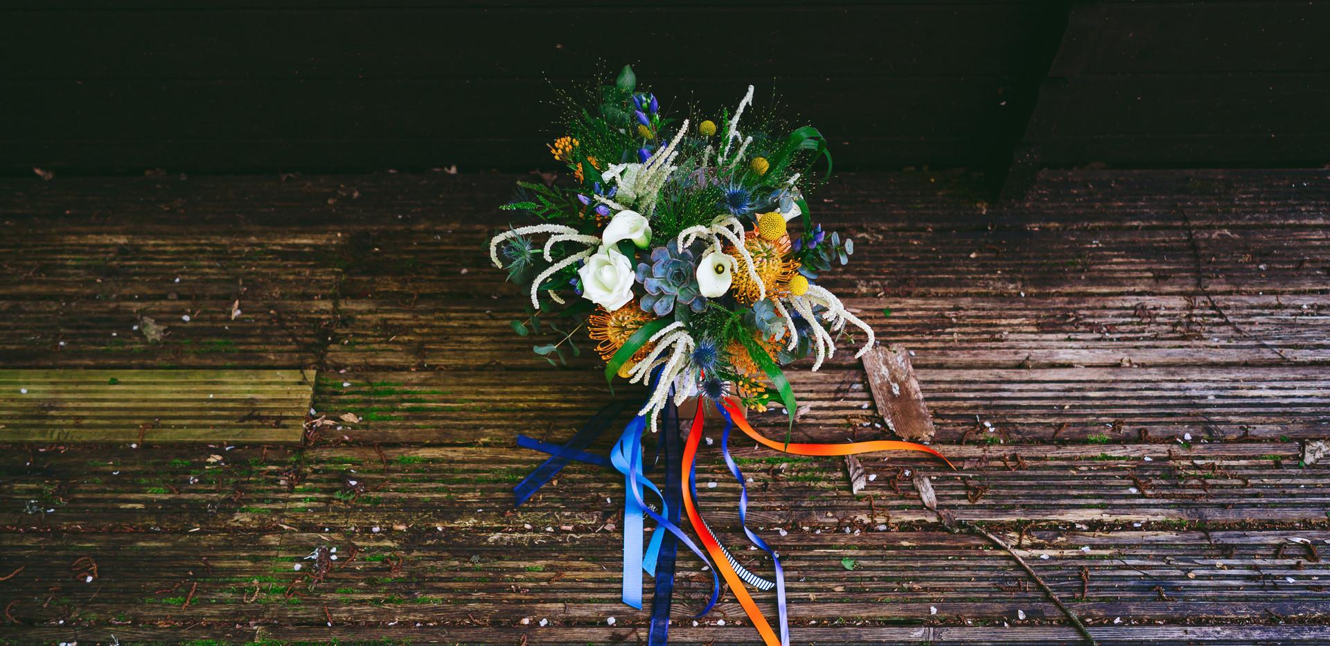 Rustic blue and orange bouquet