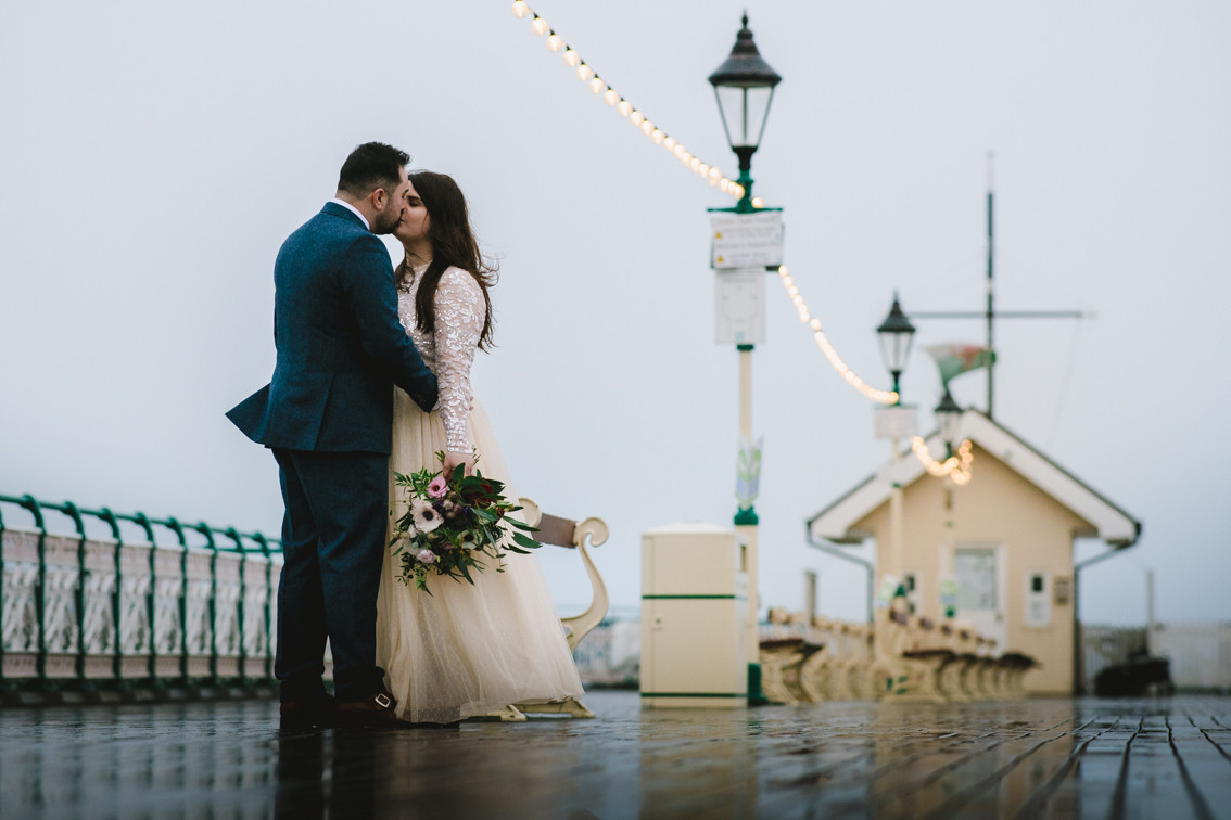 Winter wedding photo in Penarth Pier