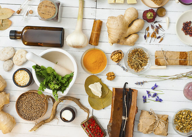 herbs and spices on white wood table.jpg