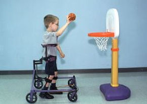Child plays basketball in SMART Walker.