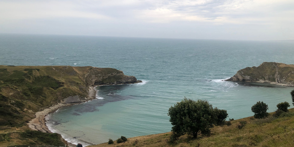 Lulworth Cove from the hill behind the house