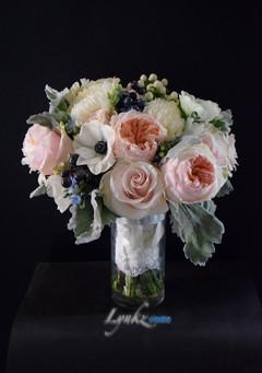 Bride's bouquet from blush roses, garden