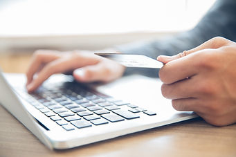 hands-holding-credit-card-typing-laptop_