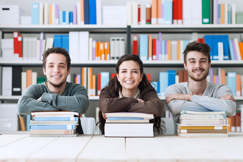 Young college students at the library st