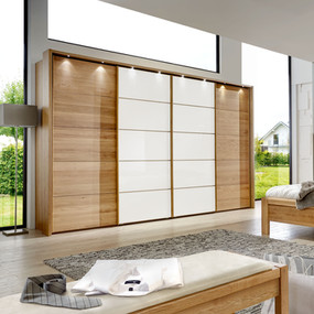 A sliding wardrobe in lacquer and melamine