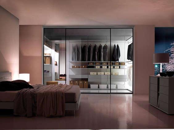 A glass walk in wardrobe
