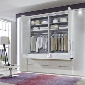 A combination wardrobe with external drawers