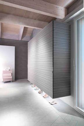 A wall hung sliding wardrobe