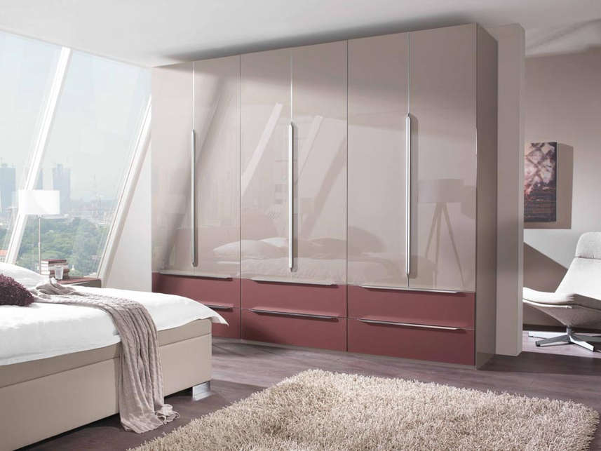 A combination wardrobe with hinged and drawer elements