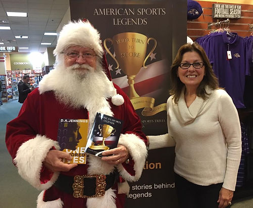 Santa Claus promotes D.A. Jennings books One Hundred Lives nd American Sports Legends