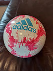 pink and white adidas soccer ball.jpg