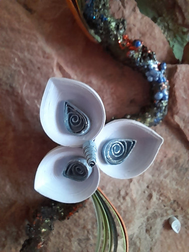 Delicate white quilled flower