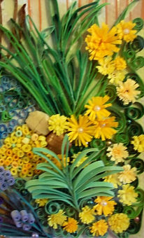Yellow paper quilled flowers and foilage