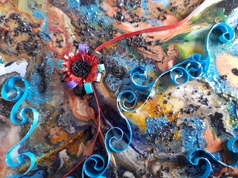 Quilling detail atop mixed media background