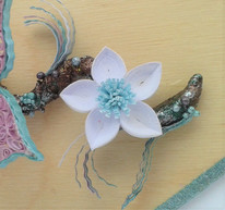 White and aqua quilled flower