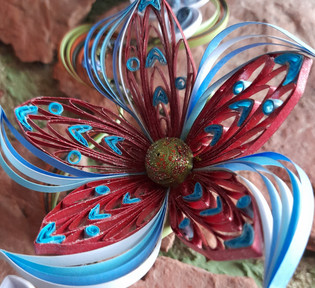 Deep red and blue quilled flower