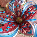 Red quilled flower
