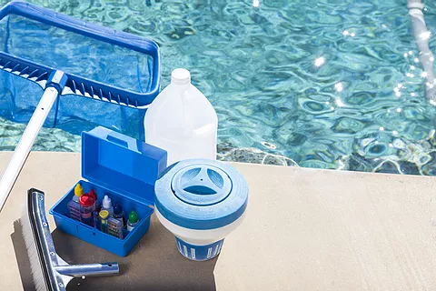 """<img src=""""pool.png"""" alt=""""pool cleaning supplies sitting by edge of pool"""">"""