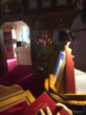 Church interior at sunset, candles, sing
