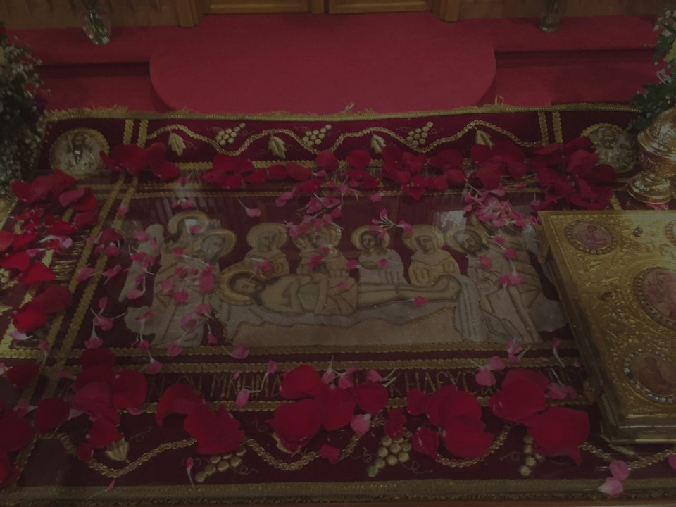 Holy Thursday Icon of  Christ in the Tomb, made of cloth and sprinkled with rose petals