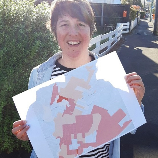 Valley Project community worker Charlotte Wilson with a map of warm-up zones in North East Valley