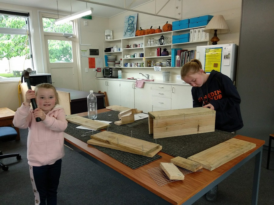 Elsie and Bella Anderson making their trapbox at the last trapbox making workshop.