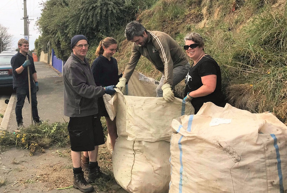 Weed warriors tackle weedy areas in the community during last year's spring clean event.
