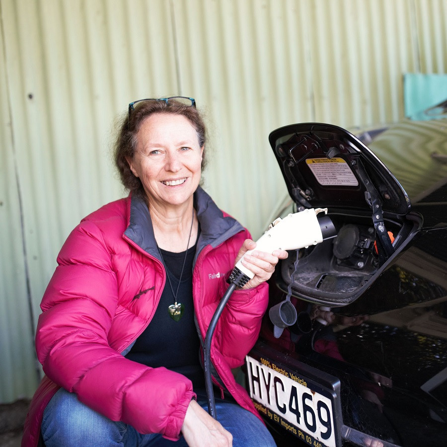 North East Valley resident Pam McKinley with her electric car