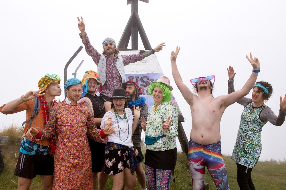 The 2019 Crush the Cargil crew dressed up for the Woodstock theme at the top of Mt Cargill, Dunedin