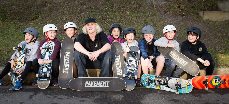 Opoho School pupils learn to skateboard with Otago Polytechnic student