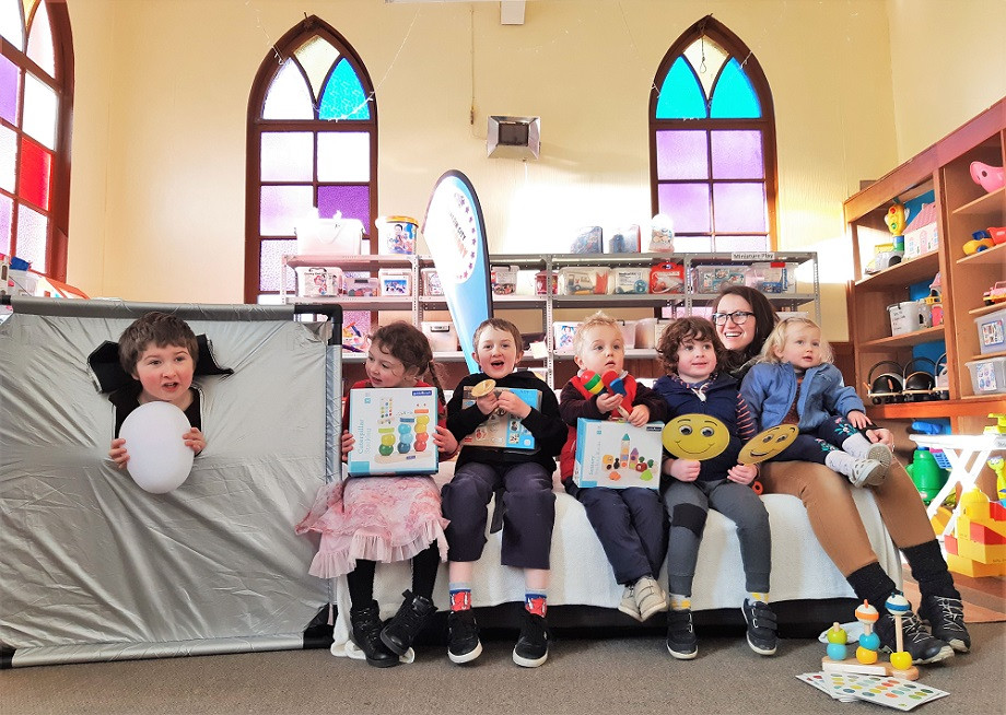 Children celebrate the arrival of new toys at the Dunedin City Toy Library in North East Valley, Dunedin