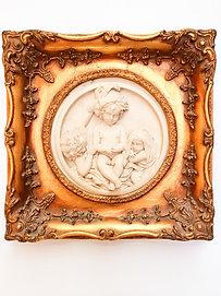 Alabaster plaque in gilded frame.