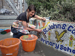 Kat installing mosaics in Bethnal Green