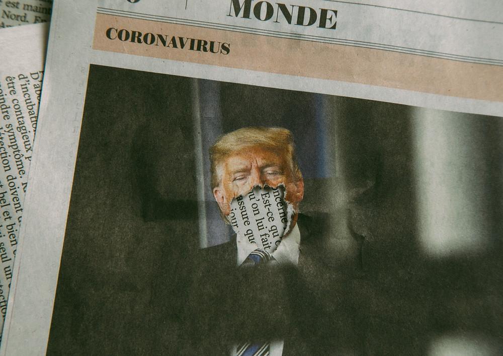 Newspaper photo of Trump finally wearing a mask.