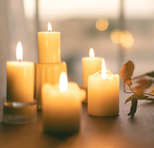Candles flickering on a table