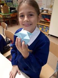 Third grader showing her origami