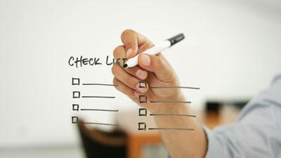 checklist on glassboard