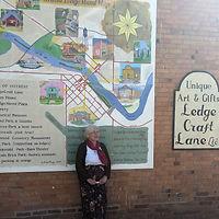 Arlene Bragg and Mural.jpg