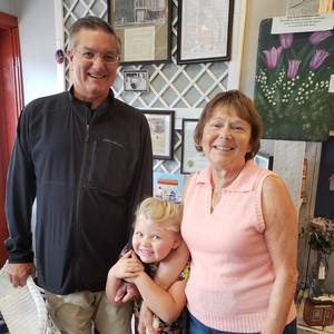 Karen & Joel Wortley and granddaughter.j