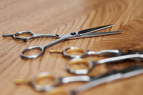 close-up-of-professional-scissors-in-hai