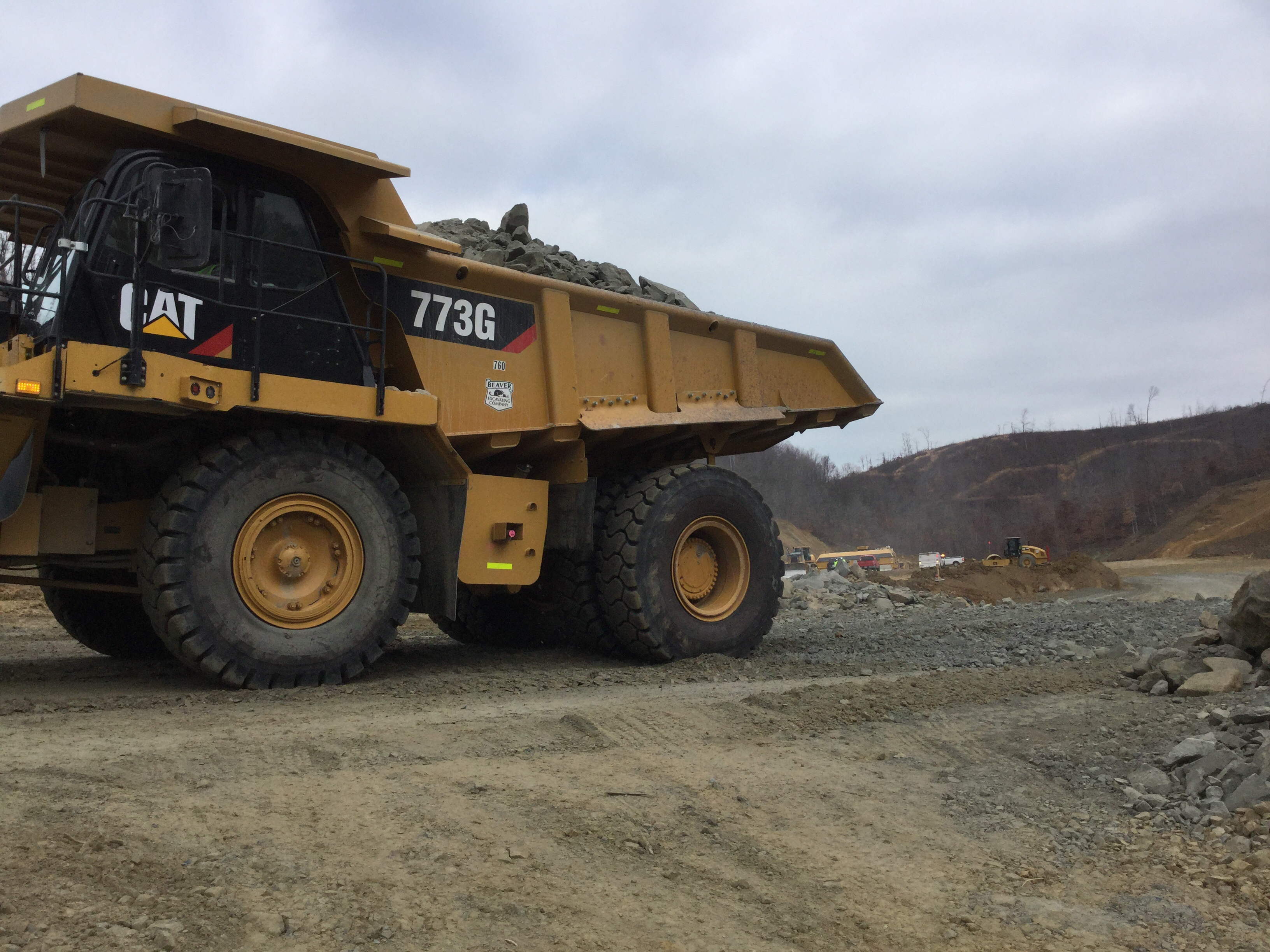 201512 Cat 773 truck dumping sandstone and shale shot rock for embankment on the mainline