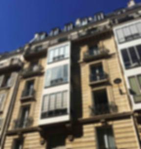 immeuble façade style post haussmann paris architecture histoire bow-window