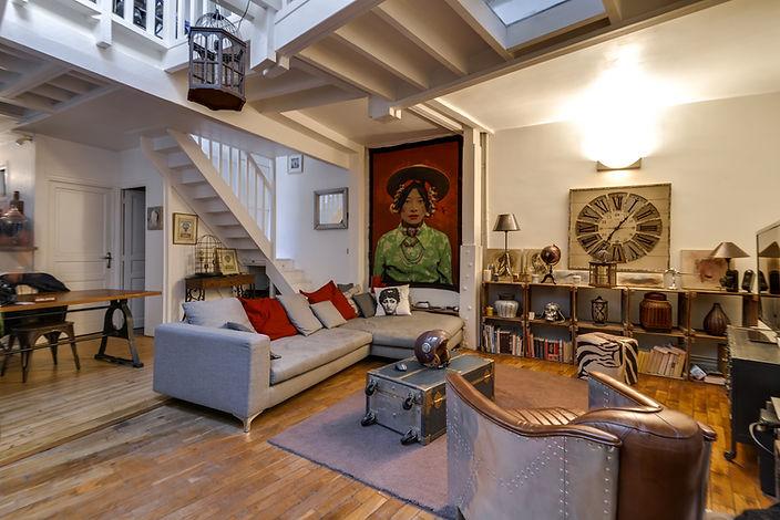 Séjour appartement loft Lamarck Paris 18 vendu par Story's