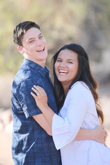 Young couple engagement photography laughing