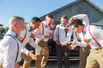 groom with groomsmen goofing off before ceremony