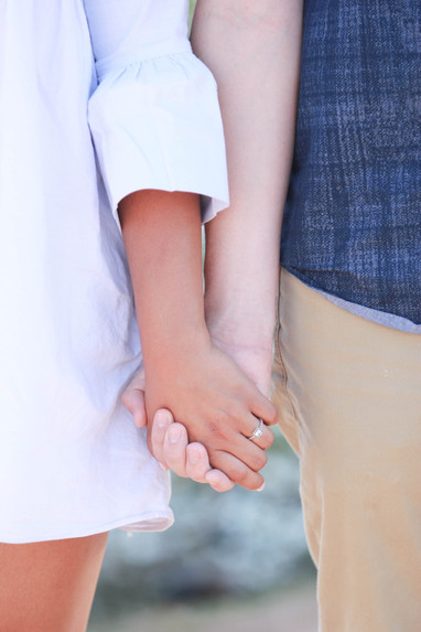 Young couple engagement photography papago park holding hands