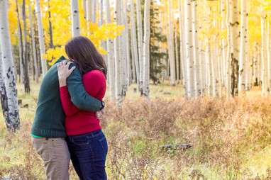 Beautiful young couple in forest for engagement photos
