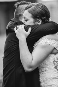 Wed couple hugs