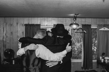 Grooms Party hugging